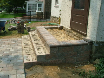 Genial Finish Wall Stones And Start To Install Bullnose Pavers (or Caps) With  Retaining Wall Adhesive: