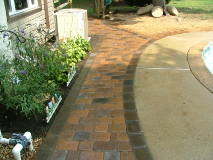 Harvest Blend Otc Walk With A 6 Inch Dakota Old Towne Cobble As Border And 20 Mixed Into Center Running Bond Pattern