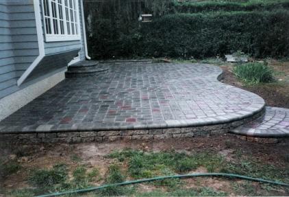 new brick patio in backyard